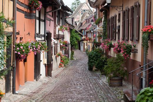 A cobblestone street in the village of Eguisheim, France.