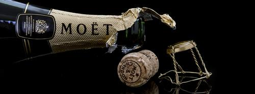 Epernay Champagne Day Tour: An open bottle of Moet & Chandon with a cork to the side.
