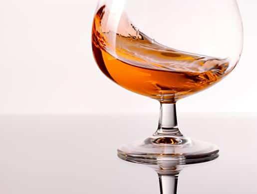 A swirling glass of Cognac.