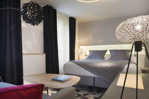 A bedroom at the Hotel Chavanel in Paris.
