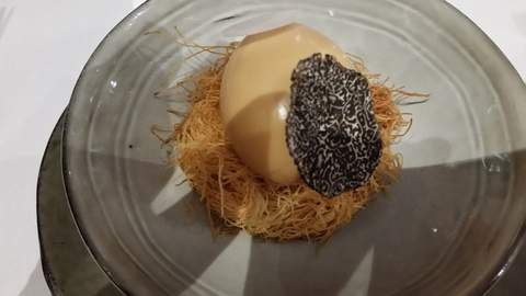A delicious plate of noodles with truffles.