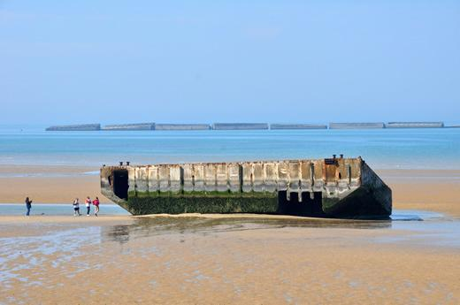 On the beach at the artificial harbor at Arromanches in Normandy, France.