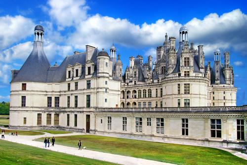 Tourists walking along the path in front of Chambord Castle in the Loire Valley.