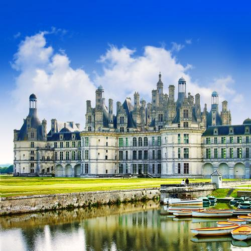 The boats at Chambord Castle on a brilliant sunny day.