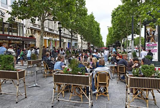 Tourists hanging out on the Champs Elysees in Paris.