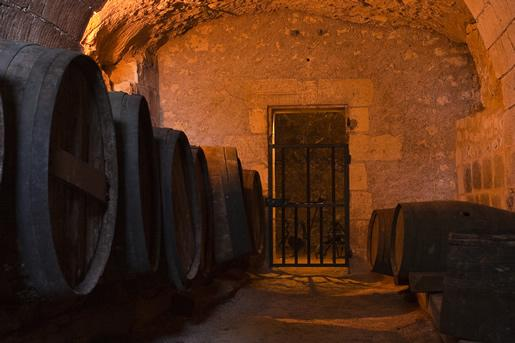 Ancient wine casks in the cellar of Château d'Usse castle in the Loire Valley.