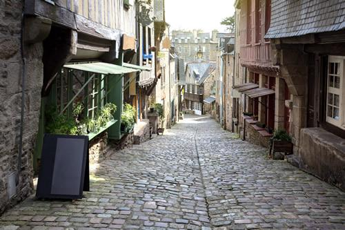 Mont Saint Michel Day Tour: A cobblestone street in the medieval town of Dinan, France.