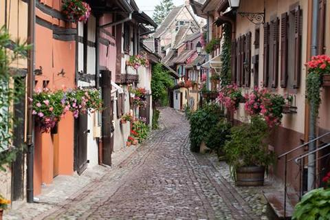 A typical cobblestone walking street in Alsace.