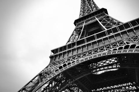 A black and white image of the Eiffel Tower.