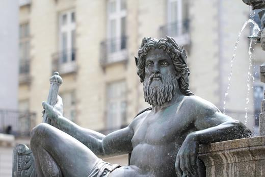 A statue in the middle of a fountain in central Nantes in the Western Loire.