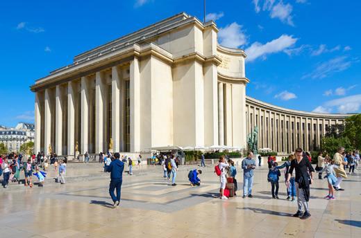 Tourists on the promenade at the Palais de Chaillot in Paris.