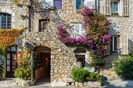 The entrance way of an old stone house in the south of France.