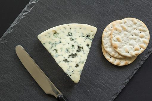 Rochefort cheese on a black platter.