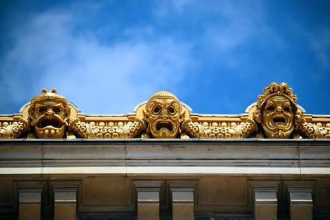 Golden statues atop the Palais Garnier opera house.