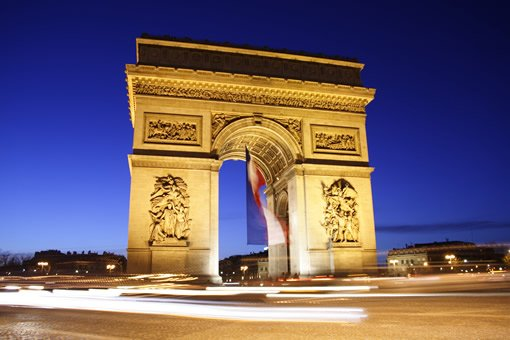 The beautiful Arc de Triomphe at night.