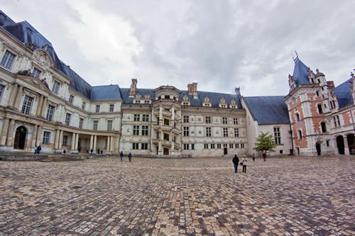 The cobblestone courtyard at Blois castle in the Loire Valley, France.
