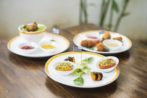 Plates of tapas on a table in Brittany, France.