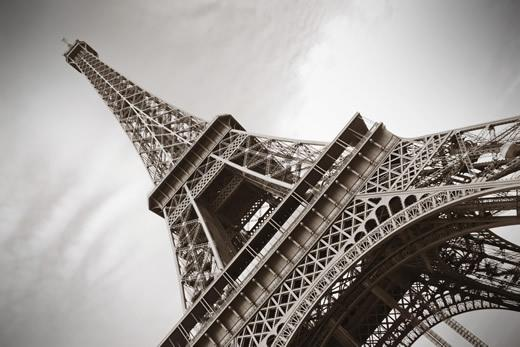 An angled black and white image of the Eiffel Tower in Paris.