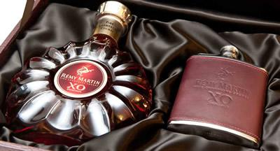 A bottle of Remy Martin cognac in a decorative case.