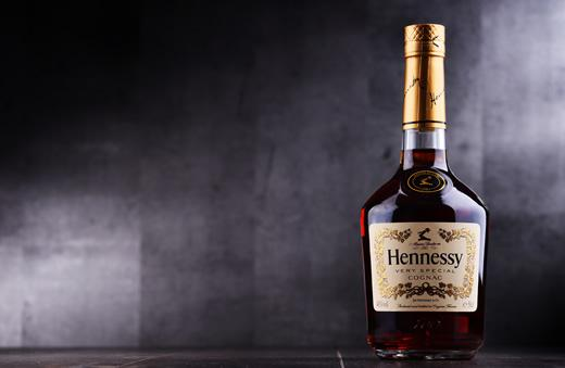 A bottle of Hennessy on a table.