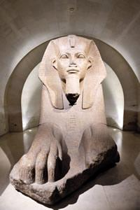 A statue in the Egyptian wing of the Louvre in Paris.