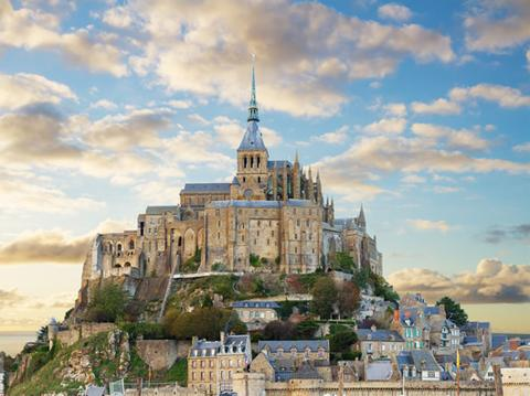 The village and abbey at Mont Saint Michel on a beautiful day.