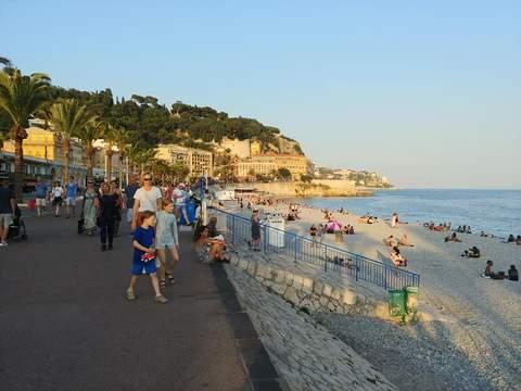 Kids walk along the promenade near the beach in Nice, France.