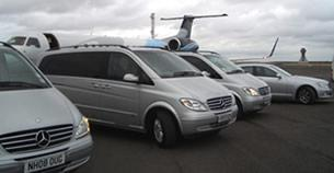 Mercedes-Benz airport transfer vehicles at Charles de Gaulle airport in Paris.