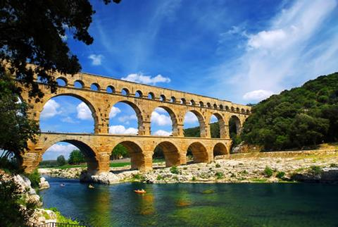 A view of the Pont du Gard in France from the river below.
