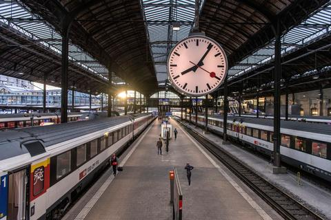 Travel to Switzerland: A classic clock at a Swiss rail station.
