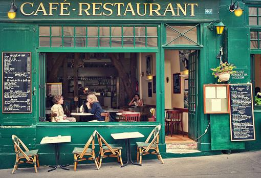 The facade of a classic cafe in Paris