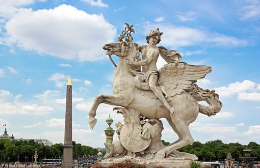 A statue of a baby on a horse in the Tuileries Garden in Paris.