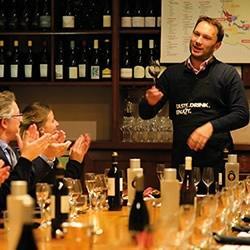 A sommelier leads a Paris wine tasting class in central Paris.