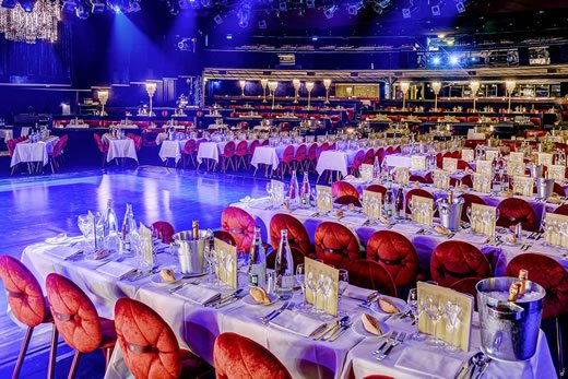 Set tables before a show at the Lido Cabaret in Paris.