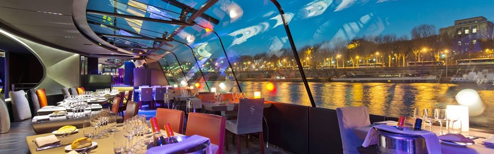 The view from inside the Bateaus Parisiens Paris Dinner Cruise.