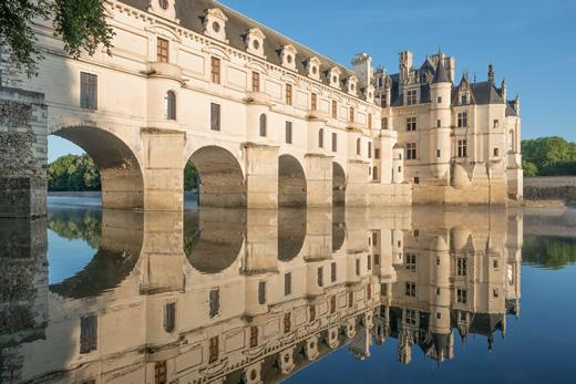 Loire Valley tour stop: Chenonceau castle with its reflection in the water.