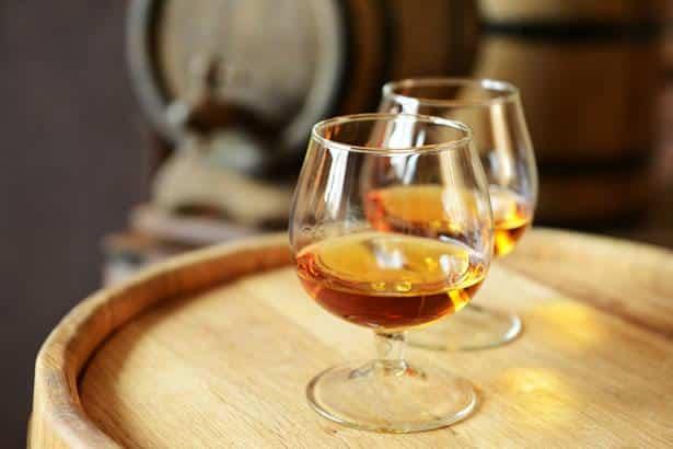 Cognac day tour: Glasses of Cognac on a new cask.